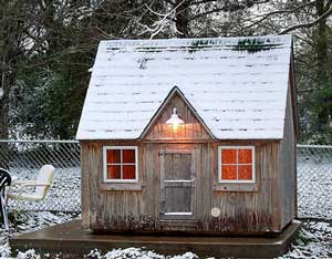 Dog kennel looking like a miniature house