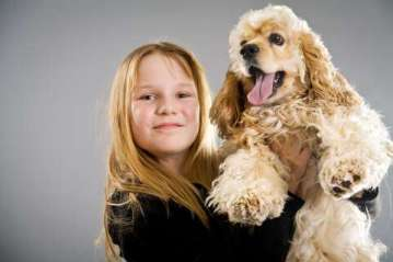 Young girl with American cocker spaniel