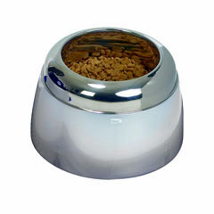 Dog food or water bowl, stainless steel, seated in a sturdy pot lifted slightly off the ground.